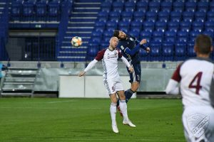 Strelec našich dvoch gólov Jakub Šulc v hlavičkovom súboji s hráčom Popradu. Foto: FB